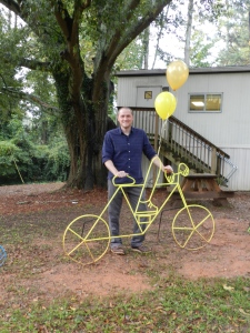 Art Teacher Nick Madden with one of the bike racks he created for College Heights ELC.