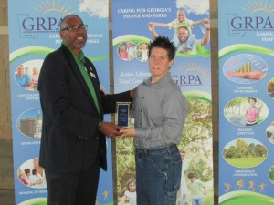 Gregory White and Lindsey Struck Accepting the Award